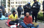 """DC Police prepare to arrest Harris Ntabkos (L) and Rudy Roberts at """"Sleepful Protest in April 2012."""