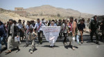 People take part in a march, denouncing plans by the Arab coalition to attack Hodeidah, from Sanaa to the port city of Hodeidah, Yemen, Wednesday, Apr. 19, 2017. (AP Photo/Hani Mohammed)