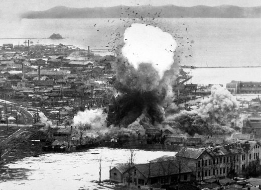US Dept of Defense-USIA US Air Force bombers destroy warehouses and dock facilities in Wonsan, North Korea, 1951.