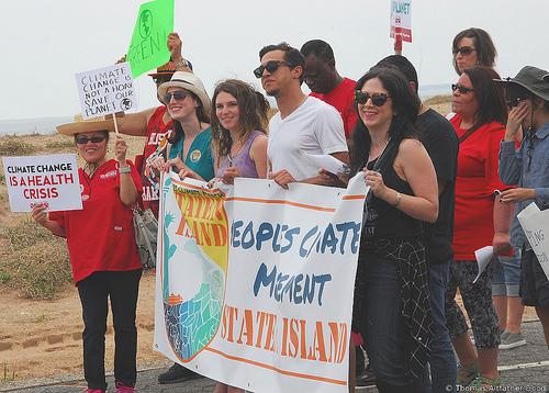 Julienne Verdi (green dress, hat) marching behind the banner (Photo: Thomas Altfather Good / Union Writer)