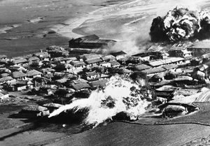 "AP ""Hit anything that moves,"" US pilots were told. Here, thatched huts go up in flames after B-26 bombers unload napalm bombs on a village near Hanchon, North Korea, on May 10, 1951"