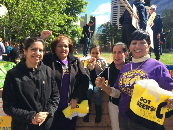 "CREDIT: RYAN GRENOBLE/HUFFPOST Eva Martinez, second from right, rallied with other union members in Denver, as protesters chanted, ""Si se puede!"""