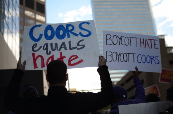 CREDIT: RYAN GRENOBLE/HUFFPOST Protesters in Denver marched to the doorstep of a major beer company.