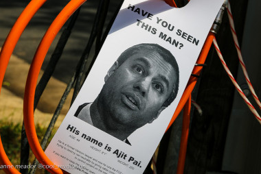 Have You Seen This Man?: Ajit Pai door hanger tangled with Verizon cables near his home in Arlington. From DC Media Group.