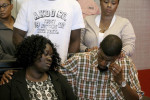 Jordan Edwards family. Father , Odell Edwards wipes away tears as he sits with his wife, Charmaine Edwards, listening to their attorney Lee Merritt talking about the death of their son. (GUY REYNOLDS for AP)