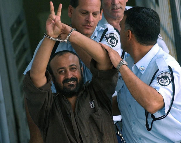 The leader of hundreds of Palestinian hunger strikers in Israeli jails, Marwan Barghouti, who has received his first Red Cross visit since the strike began, flashes the victory sign after a court hearing in 2003 The leader of hundreds of Palestinian hunger strikers in Israeli jails, Marwan Barghouti, who has received his first Red Cross visit since the strike began, flashes the victory sign after a court hearing in 2003 (AFP Photo/TAL COHEN)