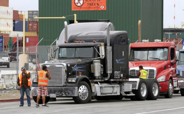 Trucks were lined up along the length of Middle Harbor Road due to a work stoppage at the SSA terminal at the Port of Oakland in Oakland, Calif., on Thursday, May 25, 2017. (Laura A. Oda/Bay Area News Group)