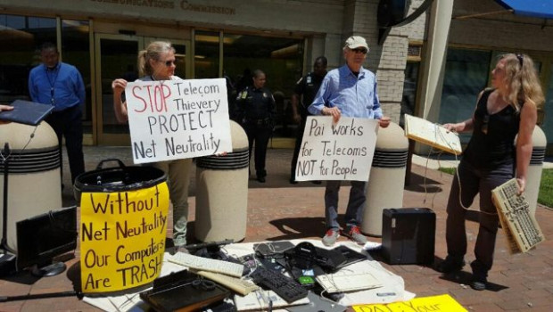 Net Neutrality advocates smash computers in front of the Federal Communications Commission on May 16, 2017./Photo courtesy of Popular Resistance