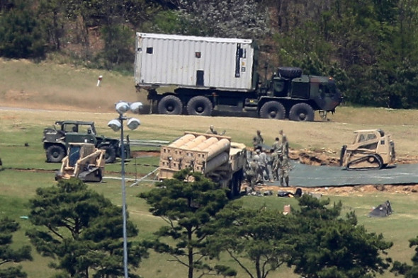 U.S. Army soldiers install the missile defence system called Terminal High-Altitude Area Defense, or THAAD, at a golf course in Seongju, South Korea, on April 27, 2017. The THAAD system is now operating and can now defend against North Korean missiles, a South Korean official said Tuesday, May 2, 2017. (Shon Hyung-joo/Yonhap/Associated Press)