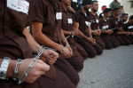 Palestinians dress up in Israeli prison uniforms, during a 19 May protest in the occupied West Bank town of Tubas, in support of some 1,300 Palestinians who have been on hunger strike in Israeli jails since 17 April.    Ayman Ameen APA images