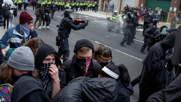 Police are accused of indiscriminate use of tear gas and pepper spray during the Inauguration Day event [Adrees Latif/Reuters]