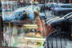 Reflections of pedestrians in a window of a restaurant on Steinway Street in Astoria, Queens, in an area known as Little Morocco that was under surveillance by the New York City Police Department, January 7, 2016. The department has agreed to even greater oversight of its intelligence-gathering programs as it tries, for the second time, to settle a lawsuit over its surveillance of Muslims. (Photo: Uli Seit / The New York Times)