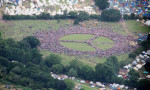 People form a giant peace sign at Glastonbury. Photograph: Andy Eliot/PA