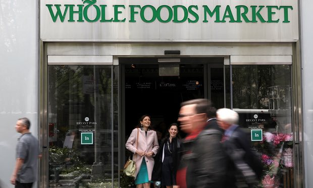 People exit a Whole Foods Market in New York. Photograph: Shannon Stapleton/Reuters