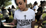 A protester demonstrates against the arrest of dozens of Iraqi Christians in south-eastern Michigan by US immigration officials. Photograph: Todd McInturf/AP