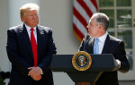 KEVIN LAMARQUE / REUTERS President Donald Trump listens to EPA Administrator Scott Pruitt after announcing his decision that the United States will withdraw from the Paris climate agreement, June 1, 2017
