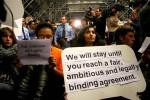 Copenhagen climate summit protest - Protestors take part in a sit-in protest inside the Bella Centre