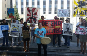 Demonstrators protest the Dakota Access pipeline outside a federal courthouse in Washington, D.C., on Wednesday. (Clara Romeo / Truthdig)