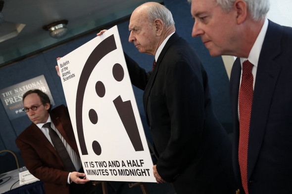 Members of the Bulletin of Atomic Scientists with the updated Doomsday Clock in Washington. The New York Times – Credit Win Mcnamee/Getty Images