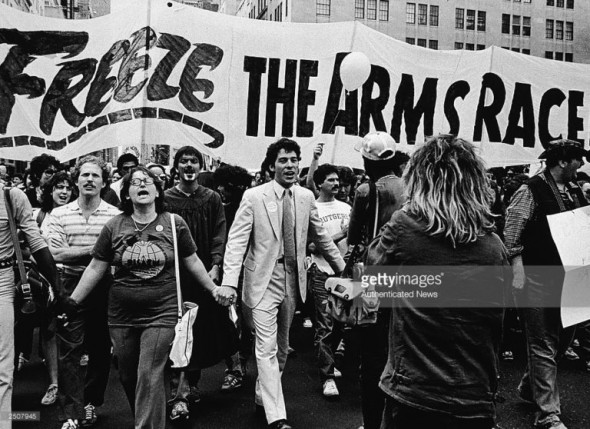 """""""The Nuclear Freeze Campaign Prevented an Apocalypse."""" — Helen Caldicott, MD – Demonstrators hold hands and vocalize as they march towards Central Park during a massive nuclear disarmament rally where 750,000 gathered to demand a freeze on nuclear arms, New York, June 12, 1982. Photo by Lee Frey/Authenticated News/Getty Images"""