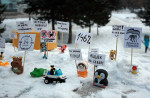 """Small dolls and other figurines display banners that read """"I'm for clean elections"""" and """"A thief should sit in jail, not in the Kremlin"""" in the Siberian city of Barnaul. (Sergey Teplyakov/Vkontakte)"""