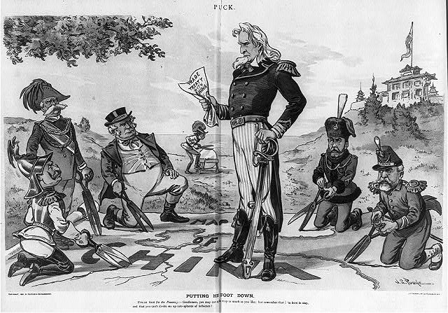 """Drawing from 1899. Uncle Sam stands on map of China which is being cut up by German, Italy, England, Russia, and France (Austria is in backgr. sharpening shears); Uncle Sam clutches """"Trade Treaty with China"""" and says: """"Gentleman, you may cut up this map as much as you like, but remember, I'm here to stay, and you can't divide Me up into spheres of influence"""". From Library of Congress."""