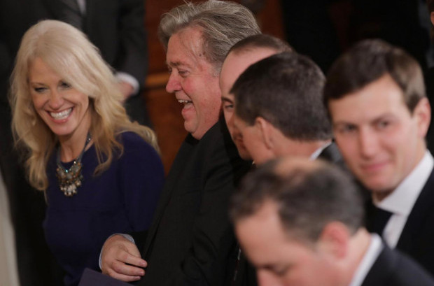 White House senior advisers Jared Kushner (right) and Kellyanne Conway (left) gather with Trump Chief Strategist Stephen Bannon (second left ) and Chief of Staff Reince Priebus (bottom) Carlos Barria/Reuters