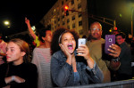 Jazz trumpeter Terence Blanchard and his daughter livestream as the crew works to take down Confederate statues. Cheryl Gerber/Reuters