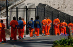 Inmates walk in file at San Quentin State Prison. (Gary Coronado / Los Angeles Times)