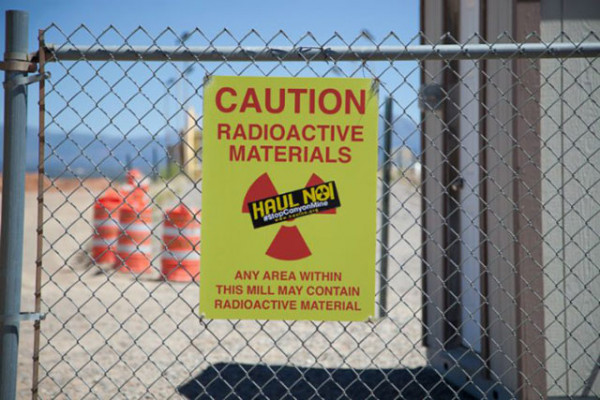 Signage at the White Mesa Mill warning of radioactive materials. (Photo: Garet Bleir)