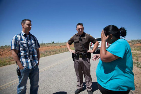 Ute Mountain Ute representative Yolanda Badback discussing with White Mesa Mill process engineer, Logan Shumway, and local law enforcement. (Photo: Garet Bleir)
