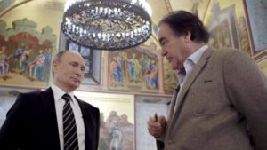 "Oliver Stone interviewing Russian President Vladimir Putin in Showtime's ""The Putin Interviews."""