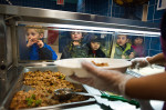 Food is served to students at Public School 397 in New York, November 21, 2013. (Photo: Joshua Bright / The New York Times)