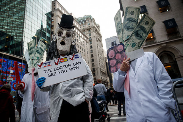 """Health care activists gather outside Trump Tower to """"declare healthcare a human right,"""" January 13, 2017, in New York City. (Photo: Drew Angerer / Getty Images)"""