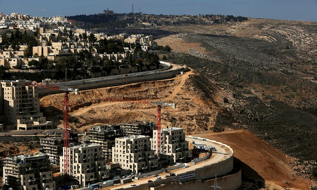 'On 11 June Avigdor Lieberman proudly announced that Israel was planning its greatest expansion of settlement homes since 1992.' Ramot in the occupied West Bank. Photograph: Ronen Zvulun/Reuters