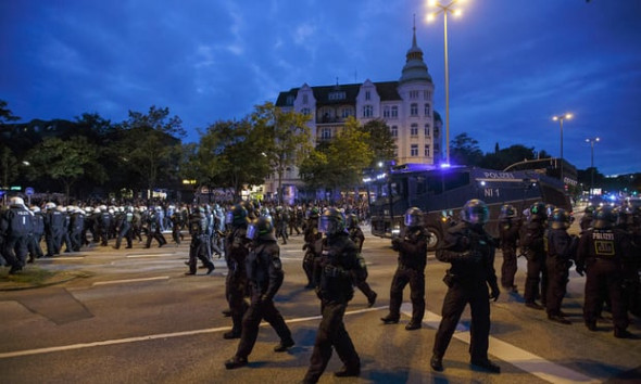 Riot police officers attend an anti-G20 protest in Schanzenviertel before the summit. Photograph: Morris MacMatzen/Getty Images