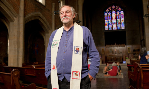 Rev Bill Wylie-Kellermann poses after having delivered his final sermon before retiring at St Peter's Episcopal Church. Photograph: Garrett MacLean for the Guardian