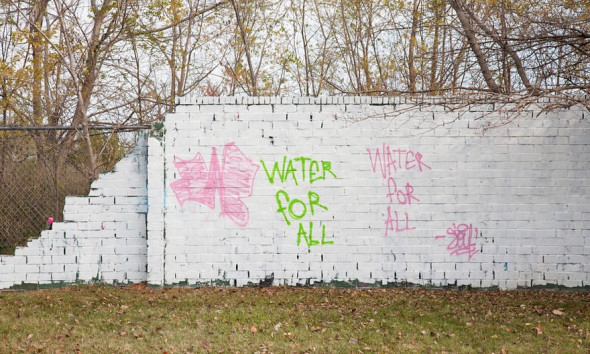 Graffiti addressing the water shutoffs covered various parts of Detroit in 2014. The city has since painted over almost all of the graffiti in that area, including the one shown. Photograph: Garrett MacLean for the Guardian