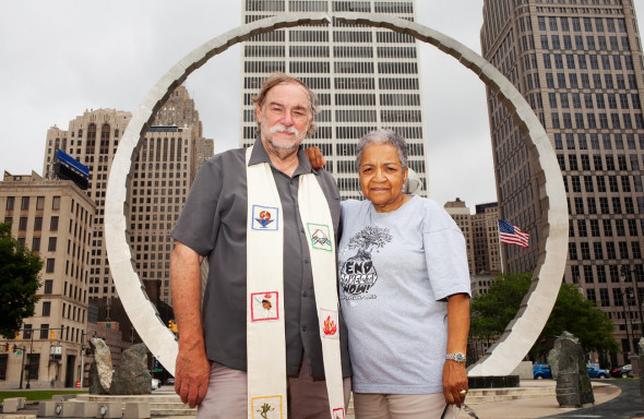 Marian Kramer and Rev Bill Wylie-Kellermann stand beneath Transcending, the monument built to honor Detroit's Labor Movement. Photograph: Garrett MacLean for the Guardian