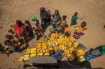 On 9 February 2016 in central Ethiopia, children and women from a semi-pastoralist community wait their turn to fill jerrycans with clean water at a water point in Haro Huba Kebele in Fantale Woreda, in East Shoa Zone, Oromia Region. Credit: © UNICEF/UN011590/Ayene
