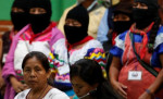 Spokesperson and presidential candidate María de Jesús Patricio, left, surrounded by members of the Zapatistas. Photo by Violeta Schmidt/Reuters