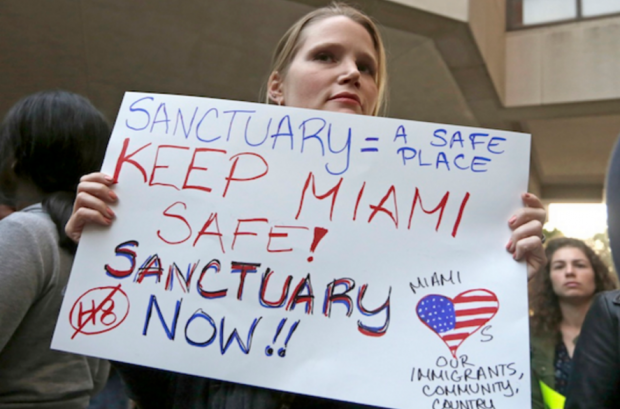 A January rally against Miami-Dade County Mayor Carlos Gimenez, who had issued an order that, in effect, assured the Trump administration the county would not be a sanctuary area. (Alan Diaz / AP)