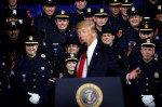 Police laugh as President Trump speaks to International Association of Chiefs of Police, July 28, 2017. Photo by Jonathan Ernst for Reuters.