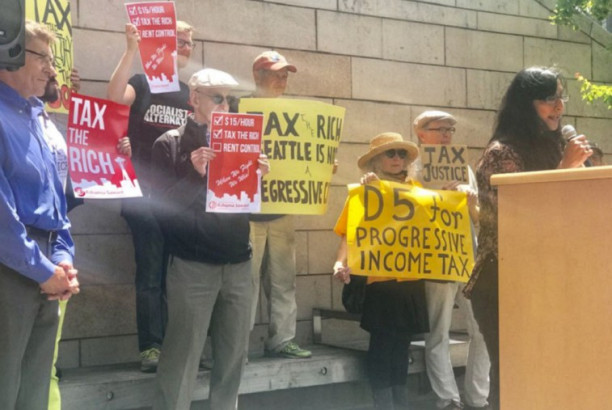 """Kshama Sawant addresses a crowd of """"tax the rich"""" supporters outside at a rally before the vote."""