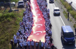 Ziya Koseoglu, AFP | Thousands of protesters hold a 1,100 meters-long national flag at the CHP Justice March on July 1, 2017.