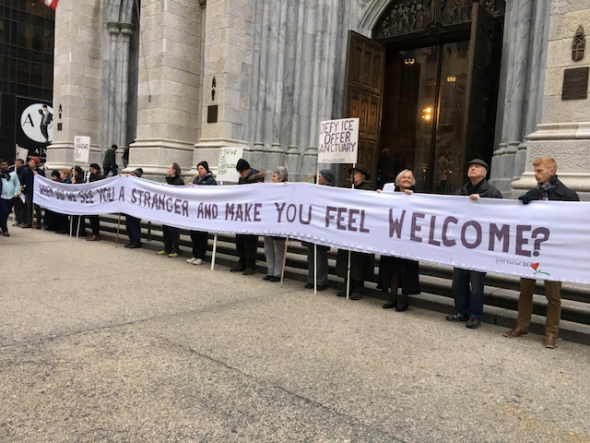 Matthew 25 protesters calling on Cardinal Dolan to denounce ICE outside St. Patrick's Cathedral (Felton Davis / Matthew 25).