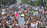 Thousands of counter-protesters march down Tremont Street.	—Matthew J. Lee / The Boston Globe