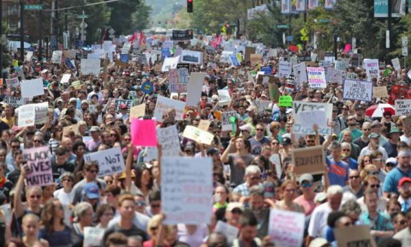 Thousands of counter-protesters march down Tremont Street.—Matthew J. Lee / The Boston Globe