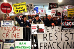 Anti-fracking protesters gather outside of the auditorium before New York Gov. Andrew Cuomo gives his fourth State of the State address on January 8, 2014, in Albany, New York. (Photo: Spencer Platt / Getty Images)