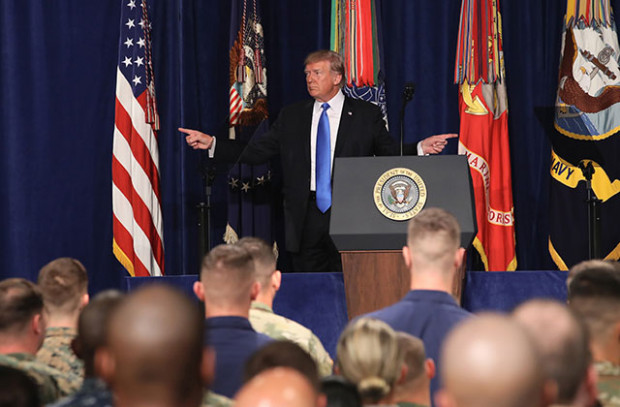 President Donald Trump gestures before delivering remarks on the US's military involvement in Afghanistan at the Fort Myer military base on August 21, 2017, in Arlington, Virginia. (Photo: Mark Wilson / Getty Images)